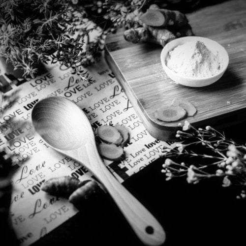 Wooden spoon and herbs