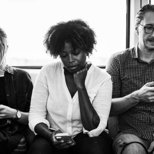 People sitting looking at their phones